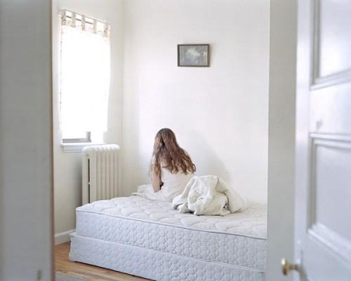 Anastasia-Caabon-sitting-on-unmade-bed