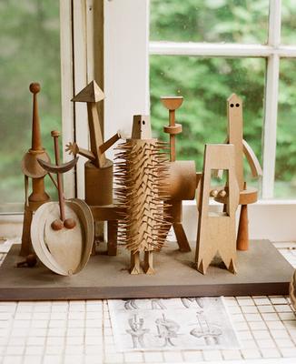Irving Harper paper sculpture figures