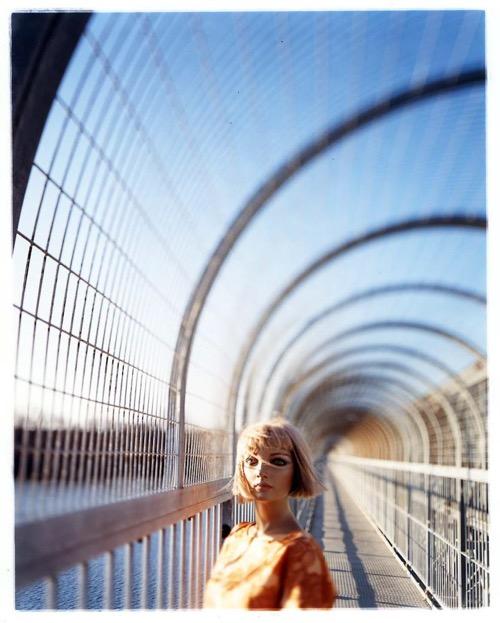 asia-kepka-on-a-footbridge