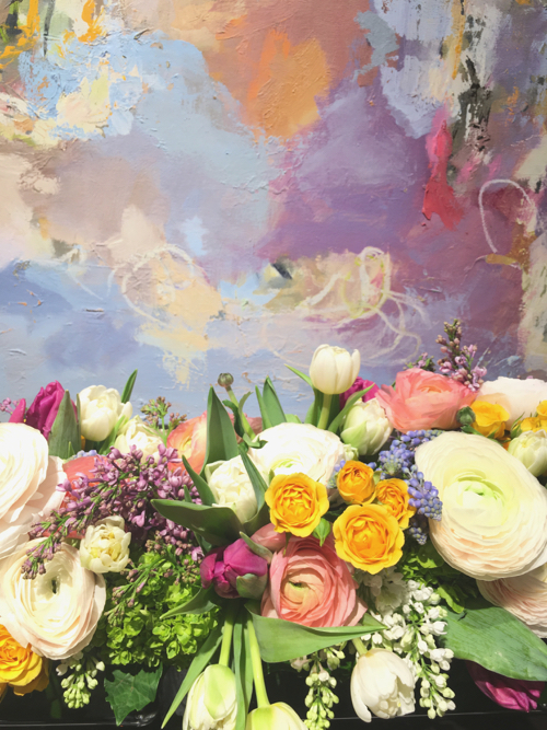 Flowers In Front Of Abstract Painting By Barbara Leiner
