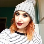 redhead in bobble hat talking about self-confidence