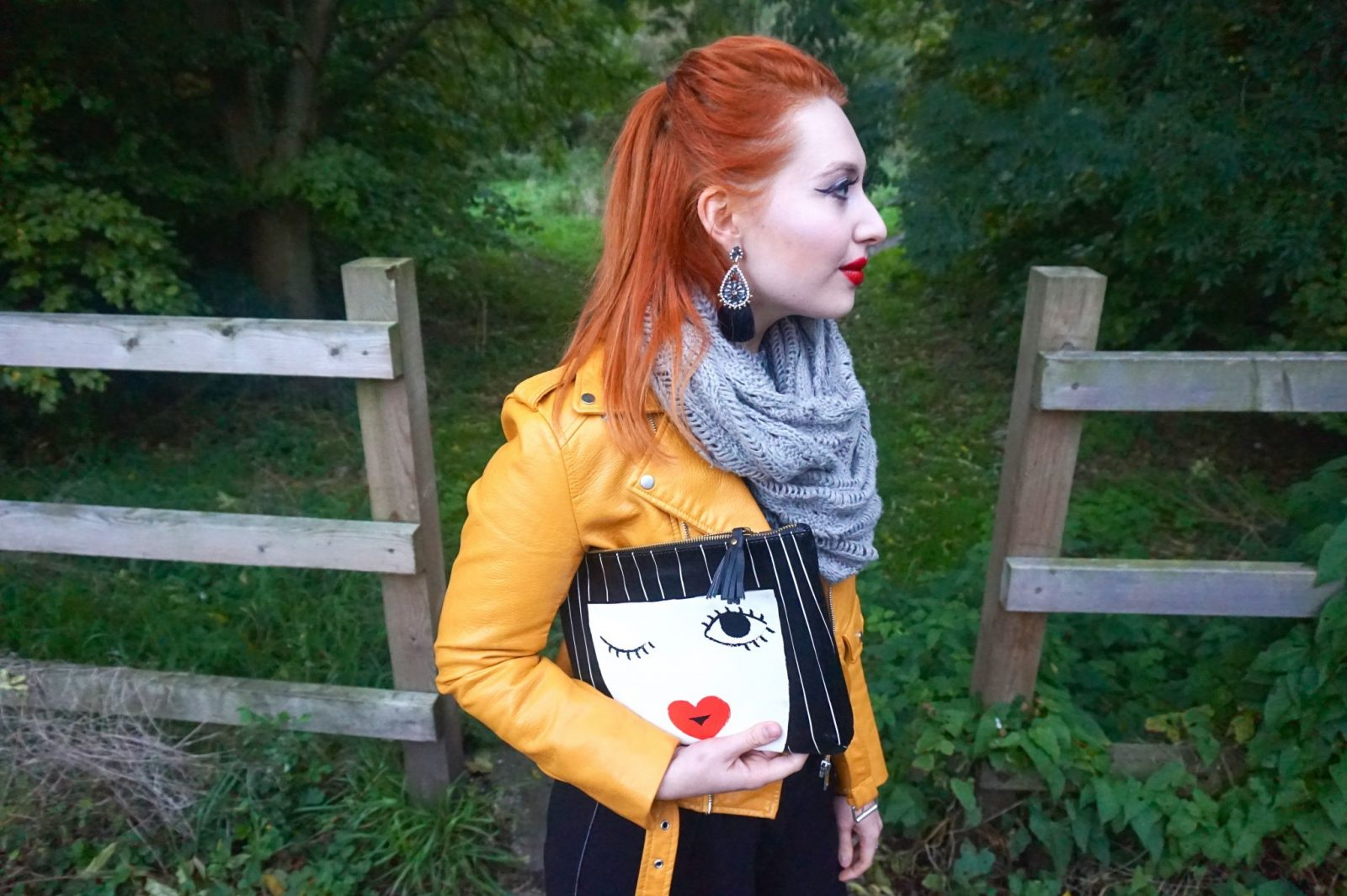 Blogger Alice from Twenty-Something City wearing autumn accessories including tassel earrings and face bag