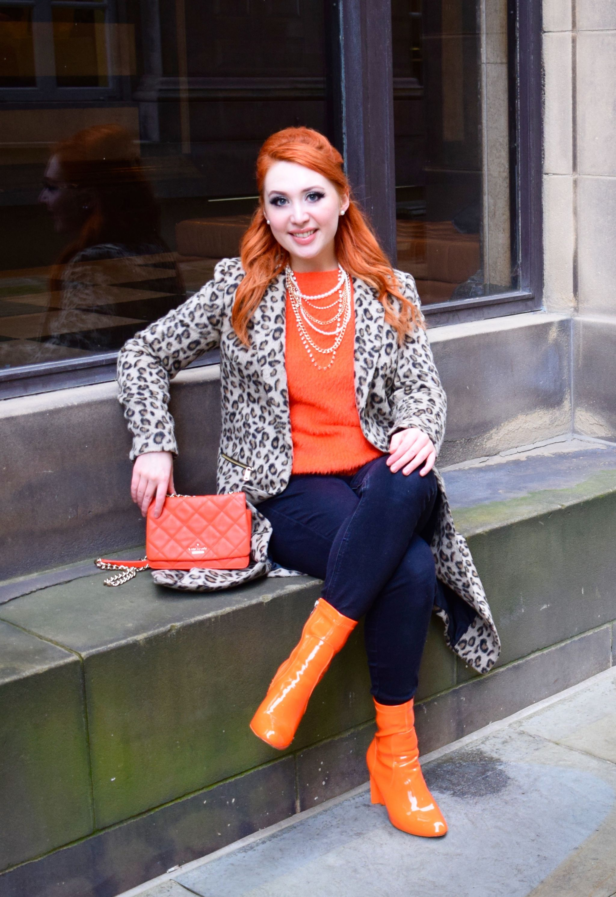 Blogger Twenty-Something City in central Manchester wearing leopard print coat and orange sock boots
