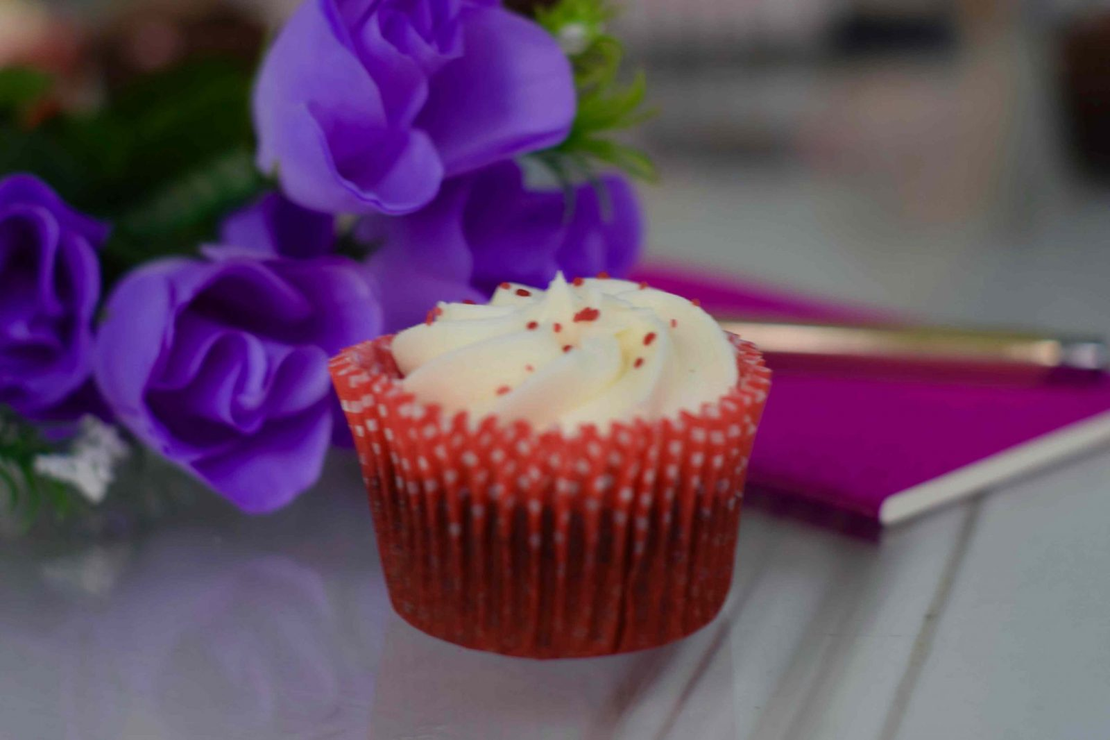 Blogger Twenty-Something City self care with purple flowers and a cupcake