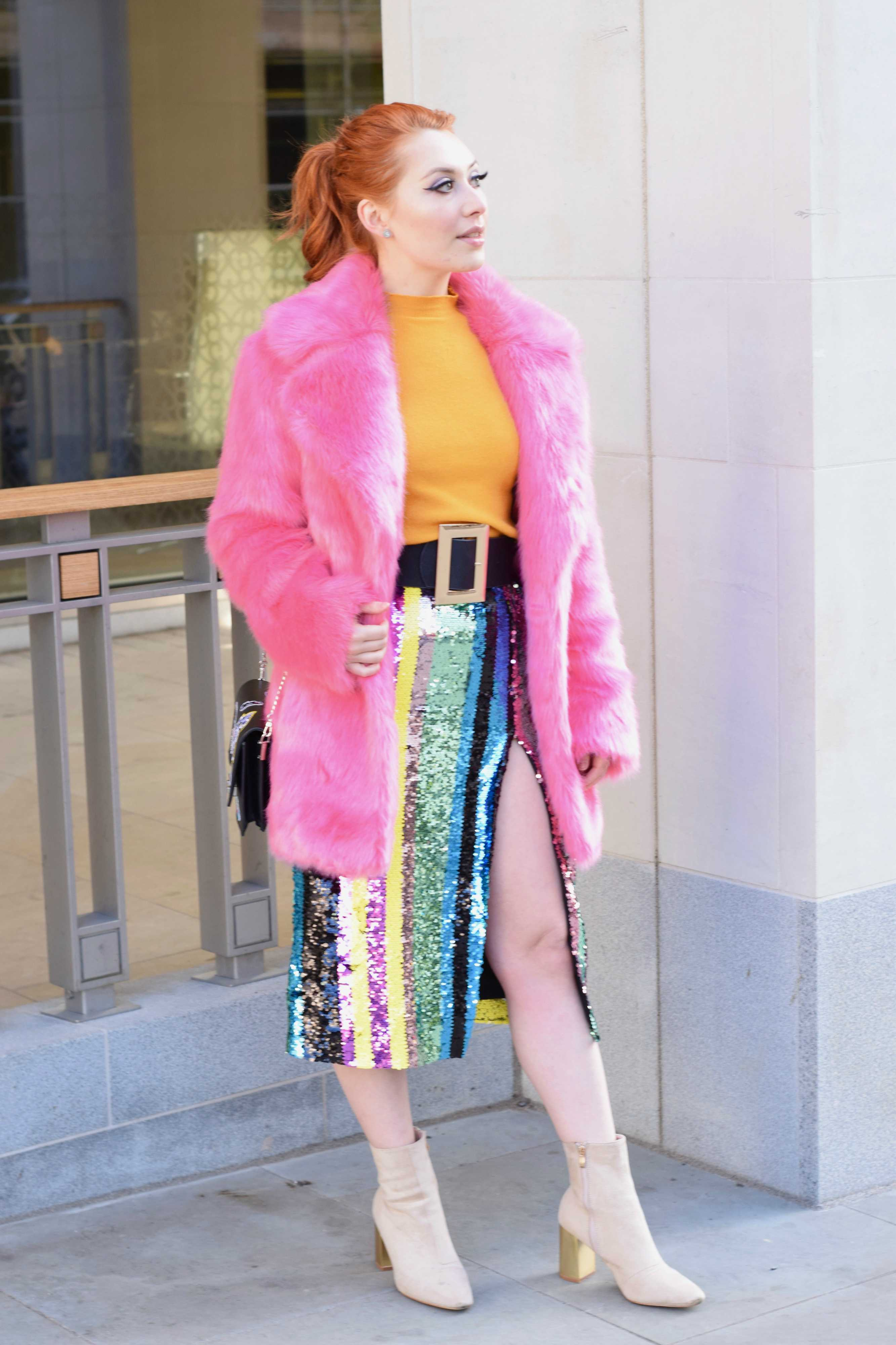 Blogger Twenty-Something City at The Strand wearing bold colourful look for London Fashion Week 2018