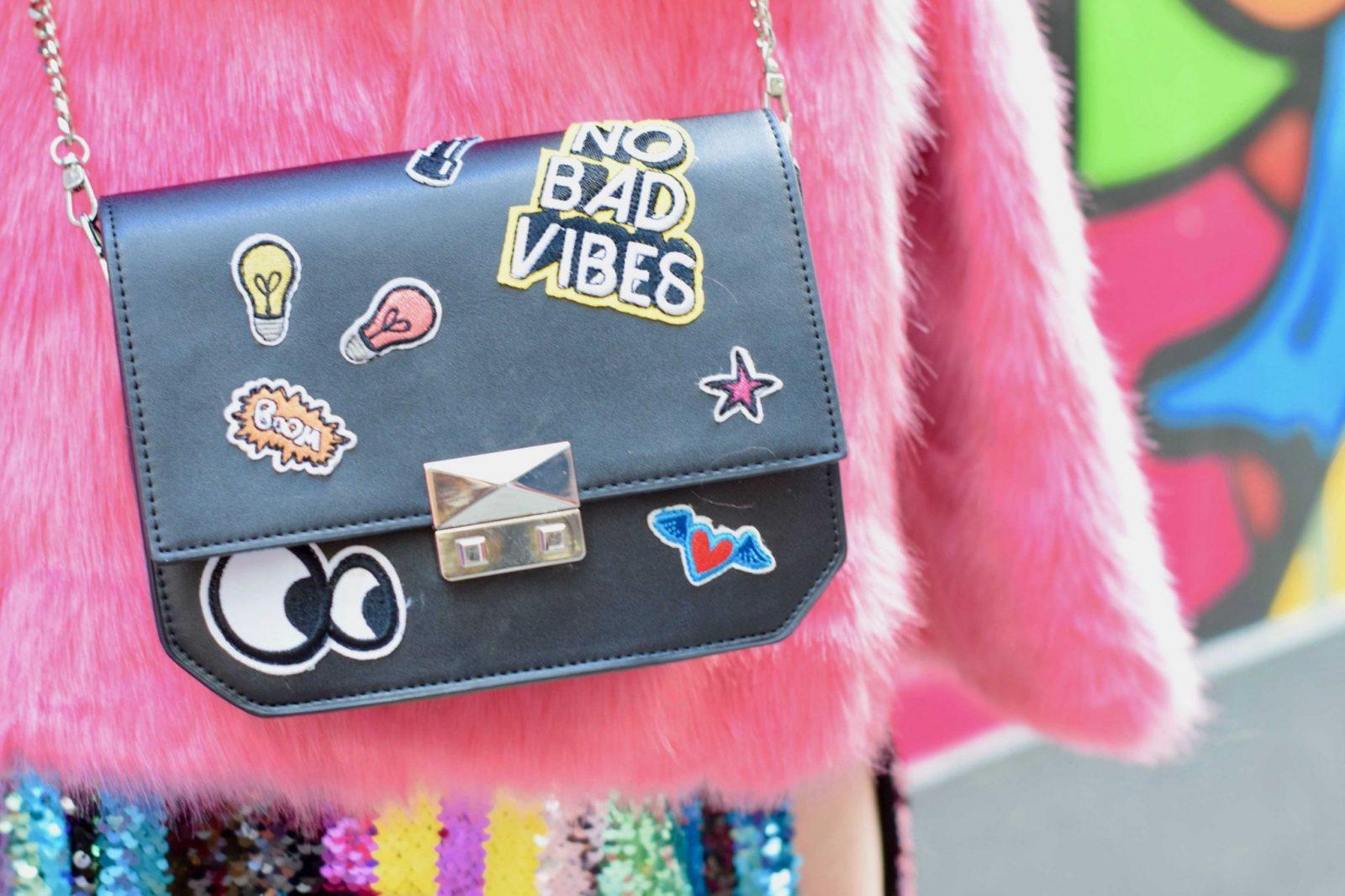 Blogger Twenty-Something City wears Zara No Bad Vibes patch badge bag for London Fashion Week 2018