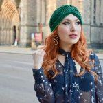 Blogger Twenty-Something City wearing green turban hat for spring fashion season