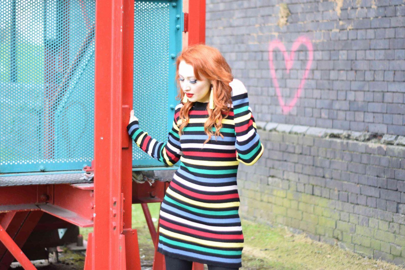 Blogger Twenty-Something City in a bright rainbow stripe dress