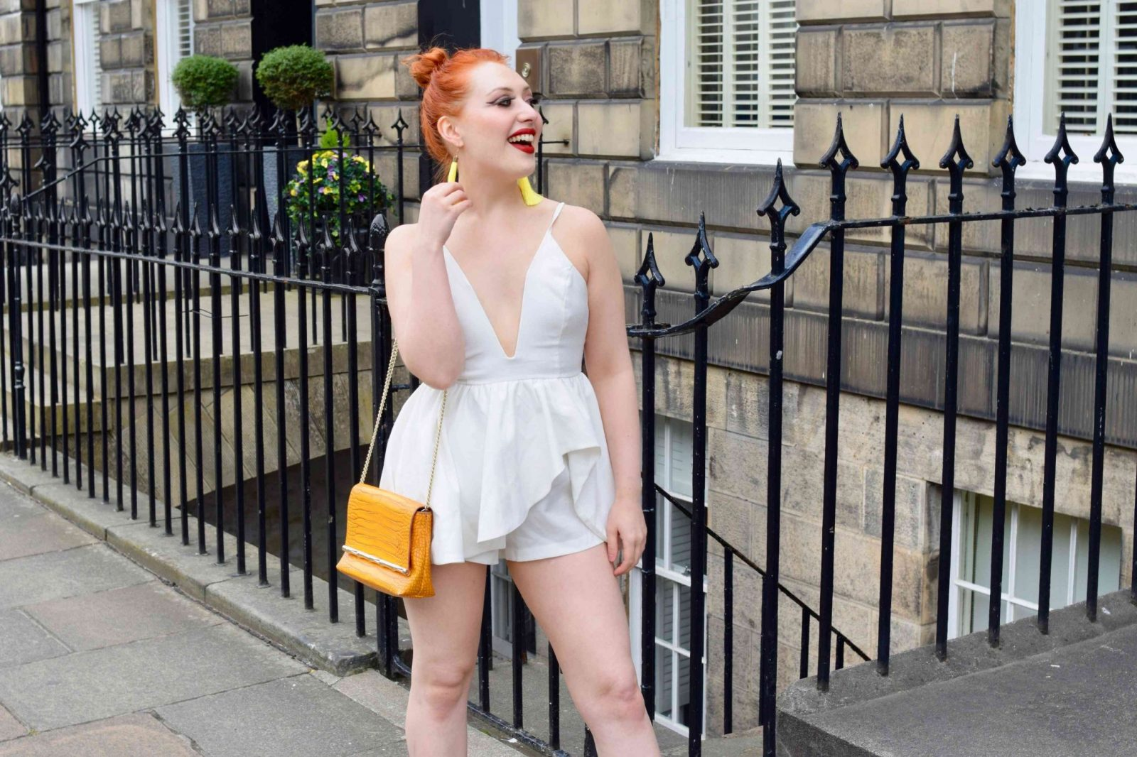 Blogger Twenty-Something City wears summery white playsuit with yellow accessories