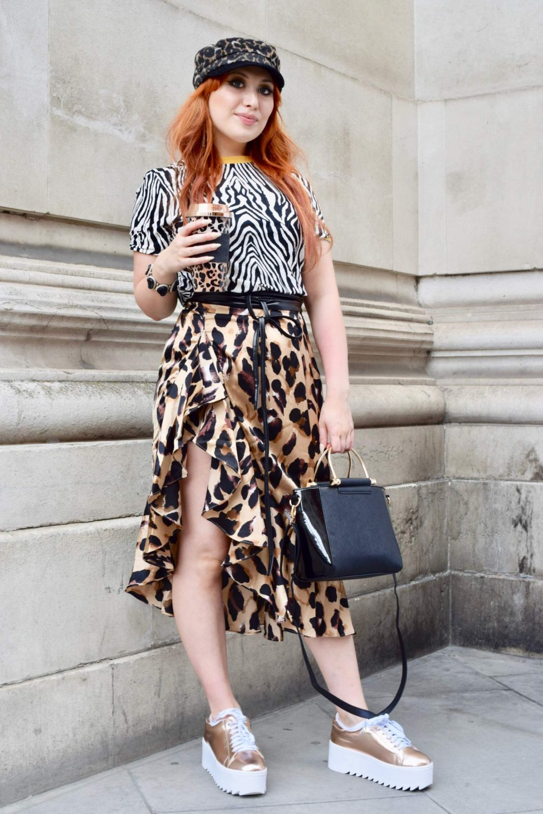 Blogger Twenty-Something City wears clashing leopard and zebra animal prints at LFW