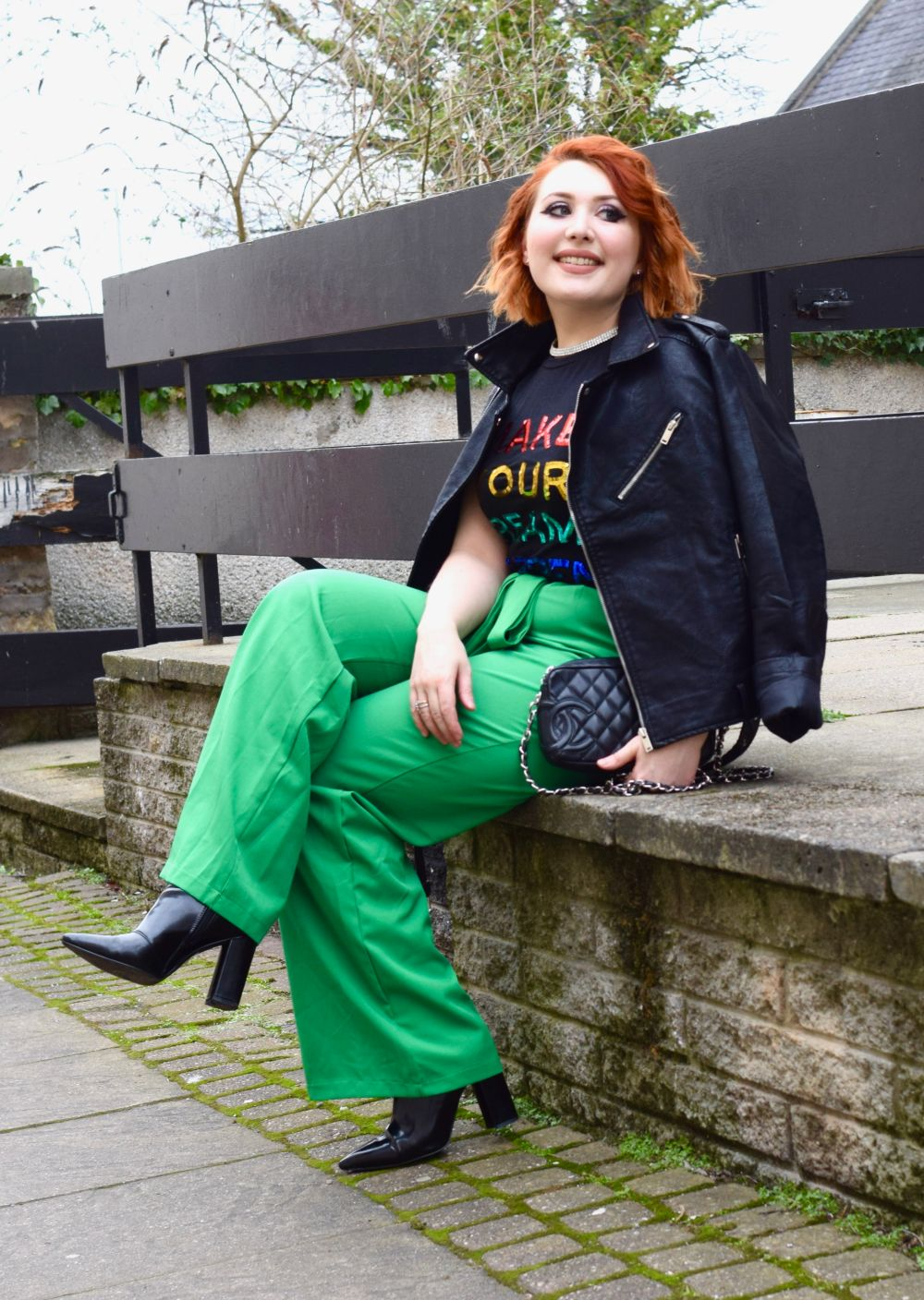 Scottish blogger Twenty-Something City wears colourful outfit and leather biker jacket