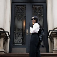 Black and White: Embroidered Shirt with Ruffle Collar, Wide Leg Overalls, Leather Biker Jacket, White Kitten Heel Mules, Jimmy Choo Padlock Bag and Cat-Eye Sunglasses