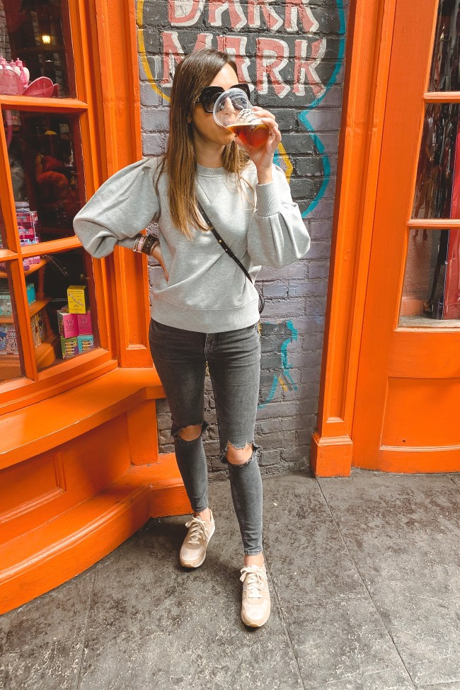 rebecca minkoff grey sweatshirt with lv palm springs mini at harry potter world drinking beer