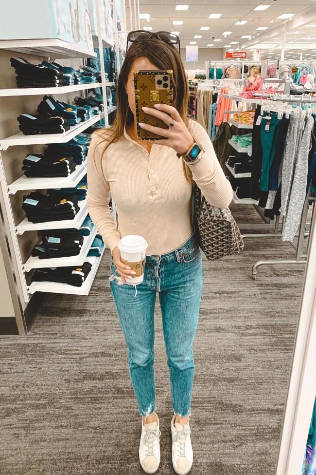 tularosa lela bodysuit with agolde jeans and goyard