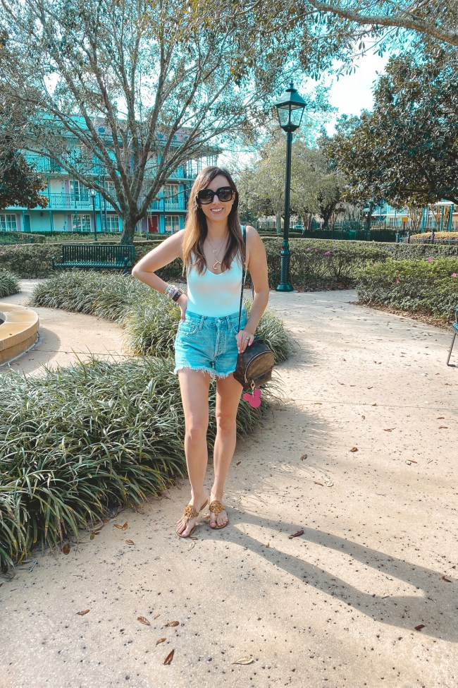 superdown white bodysuit with lv palm springs and denim shorts