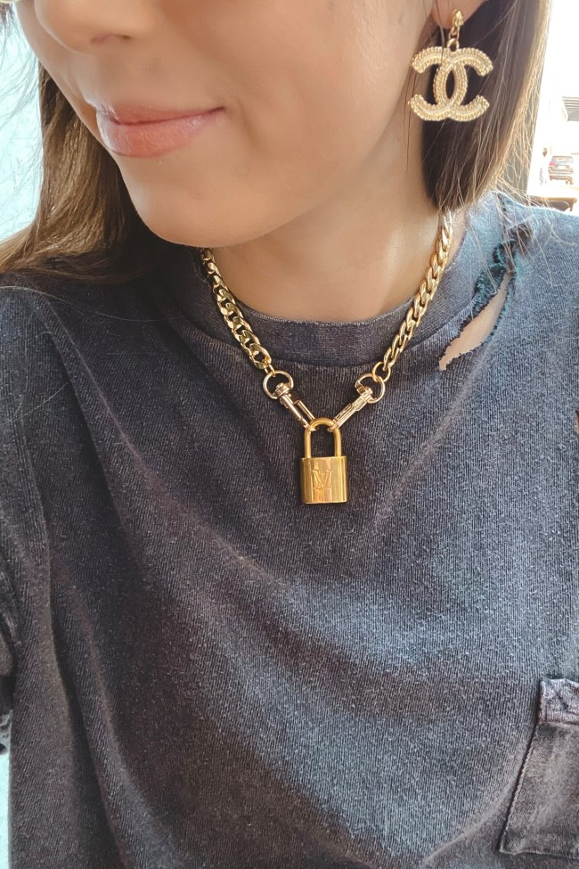 free people black rubi tee with louis vuitton lock necklace and chanel earrings