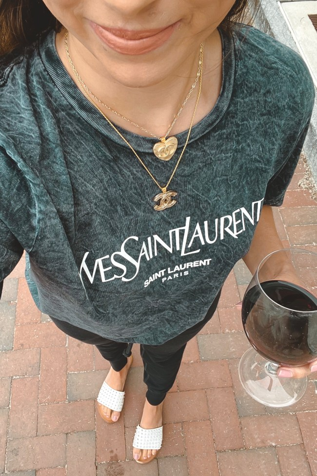 ysl black acid wash tee with chanel layered necklaces and wine