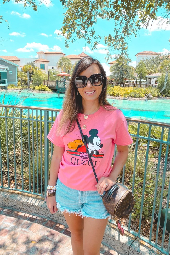 pink mickey mouse gucci tee with agolde shorts and louis vuitton palm springs mini