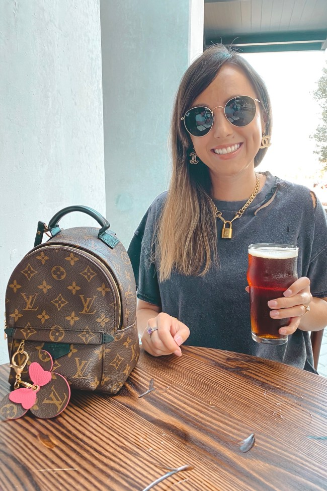 free people black rubi tee with louis vuitton lock necklace and palm springs mini