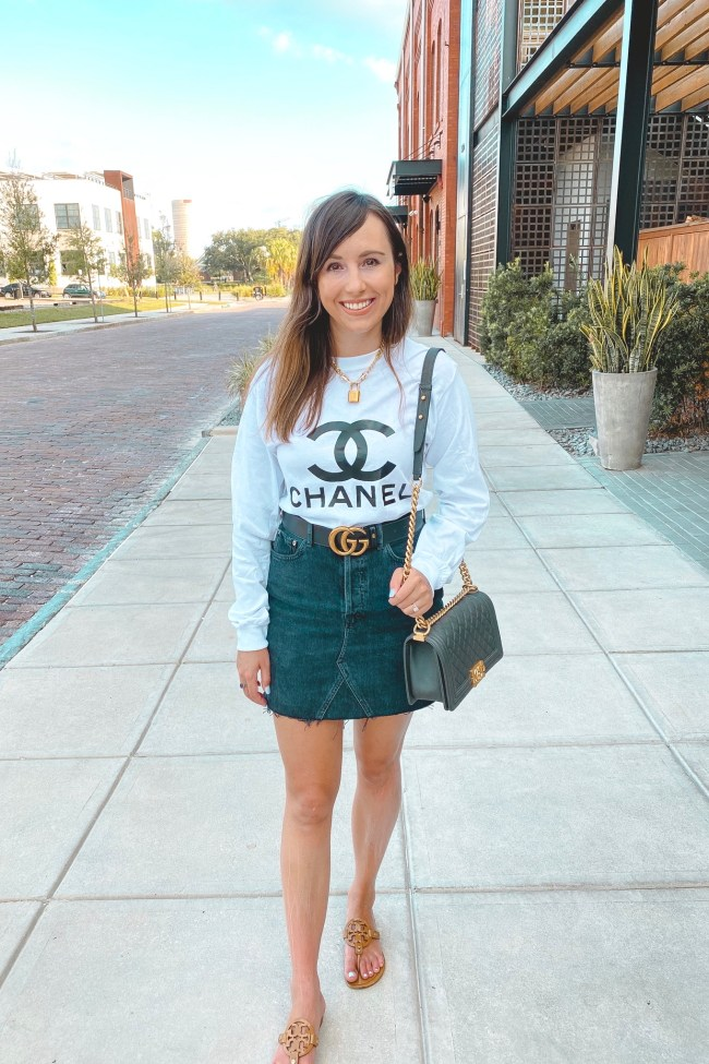 chanel white long sleeve with black agolde denim skirt and gucci belt