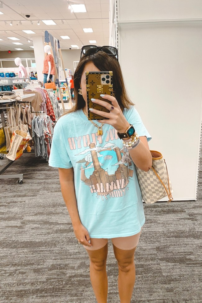 blue pink floyd tee with pink bike shorts and louis vuitton neverfull