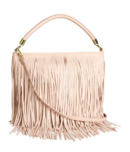 Shoulder bag in imitation leather with fringe. Top zip, handle, and detachable shoulder strap. Three inner pockets, one with zip. Lined. Size 12 1/4 x 13 1/4 in. $29.95