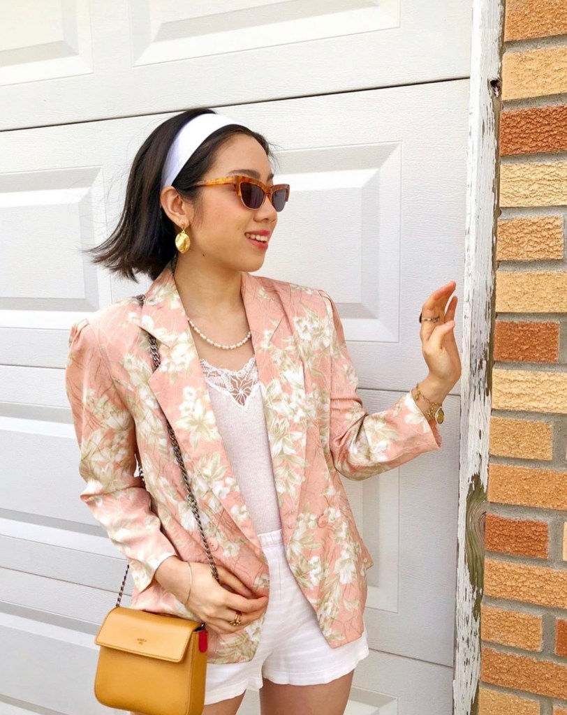 Vintage peach colored floral blazer, yellow handbag, sunglasses, headband, quarantine