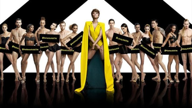 America's Next Top Model -- Image Number: ANTM22_KeyArt.jpg -- Pictured: Tyra Banks (Center) with Cycle 22 Contestants (L-R): Ava, Nyle, Hadassah, Devin, Delanie, Dustin, Ashley, Stefano, Lacey, Bello, Courtney, Justin, Mamé and Mikey -- Photo: © 2015 The CW Network, LLC. All rights reserved.