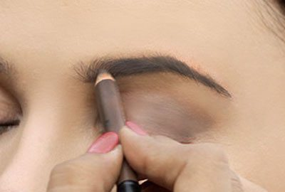 Fill in eyebrows using pencil eyeliner