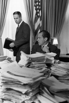 6/14/02, WASHINGTON DC, UNITED STATES --- Undated File Photo: President Richard M. Nixon sits behind a mound of papers as he speaks with his chief of staff, H.R. Haldeman, in the White House. Haldeman was later convicted for his role in the Watergate scandal; Nixon was eventually forced to resign the presidency. --- Photo by Bettmann/Corbis