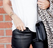 Le-Fashion-Blog-Blogger-Style-White-Tee-Gold-Rings-Layered-Bracelets-Chain-Strap-Bag-Helmut-Lang-Black-Leather-Pants-Via-Damsel-In-Dior