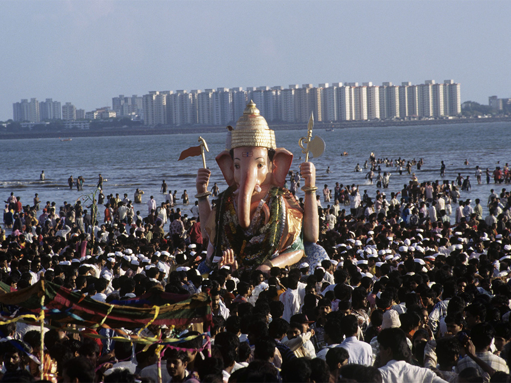 Devotees gather on the beach for the procession