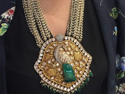 Carved Russian Emerald Set With Polki Diamonds In Gold- Ghatiwala Jewellers.