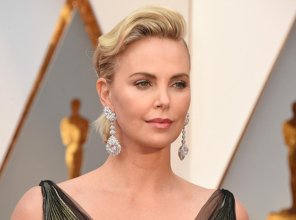 """Charlize Theron wore a pair of statement earrings by Chopard featuring a 25-carat pear-shaped D-flawless diamond and 26-carat heart-shaped D-flawless diamond, 4.55-carats of pear-shaped diamonds and 4.35-carats of brilliant-cut diamonds set in 18k white 'Fairmined' gold from the """"Garden of Kalahari Collection."""" If you can remove your eyes from the earrings she also wore a ring with a 7.11-carat pear-shaped diamond and 1.14-carat of diamonds set in 18k white gold, and a diamond ring featuring a 4.04-carat diamond set in 18k white gold, both from the """"High Jewelry Collection."""" PC- Forbes"""