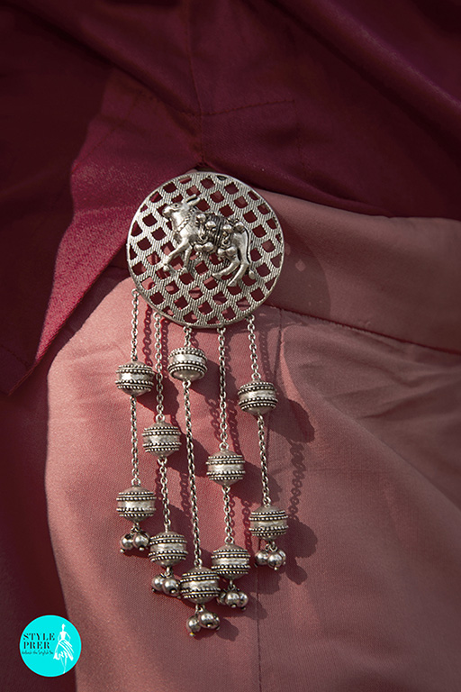 Silver Keychain With A Cow Motif, Disc Like Danglers And Ghungroos