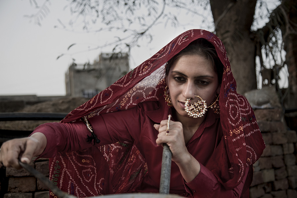 Traditional Living, Hi-Aspirations! Adorning A Gold Plated Silver Nose Ring (Nath) With Bird Motifs, Red And White Stones And Pearls