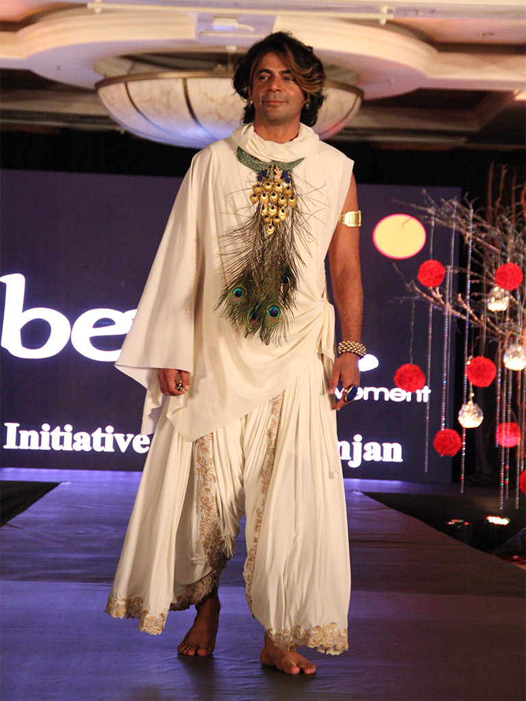 """Sunil Grover wearing """"Madhuban"""" handmade Silver Necklace with real Peacock feathers from Adore, dressed as Lord Krishna at the Beti Foundation Jewelry and Fashion Show"""