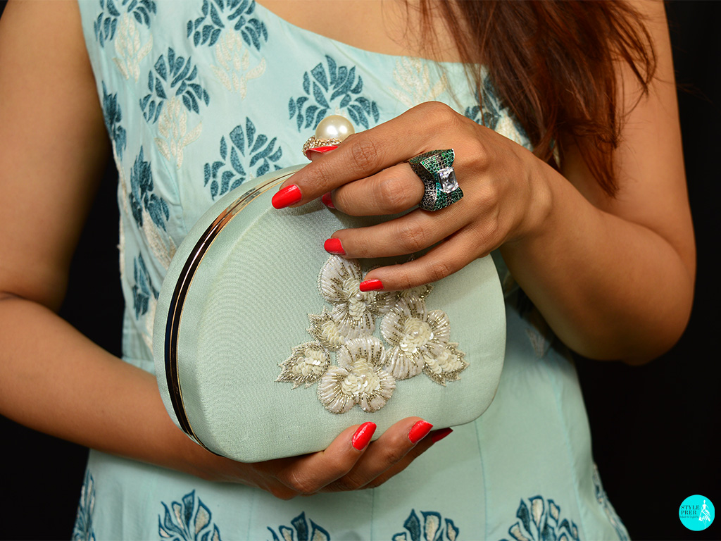 Modern Gemstudded Cocktail Ring By Tsara From Velvetcase. Gown And Clutch - Anj Kreations