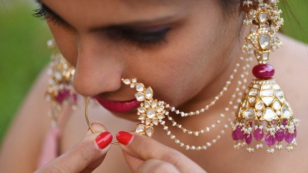 Wearing Polki (Uncut Diamond) And Ruby Jhumkas Along With A Round Bold Polki And Pearl Nath (NoseRing) By Birdhichand Ghanshyamdas Jewellers