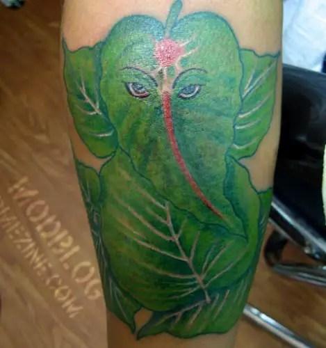 Leaf Ganesha Tattoo On Leg