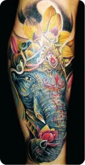 Lotus With Elephant Tattoo On Hand