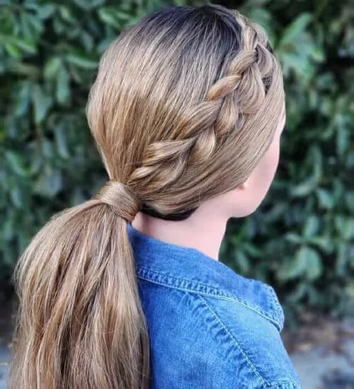low sleek braided ponytail