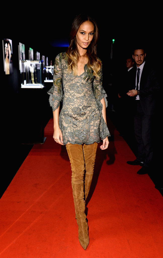 Joan Smalls paired her Pucci OTK boots with a grey lace dress...cute!