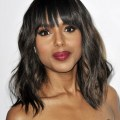 Chic medium soft wavy hair style with blunt bangs for black women