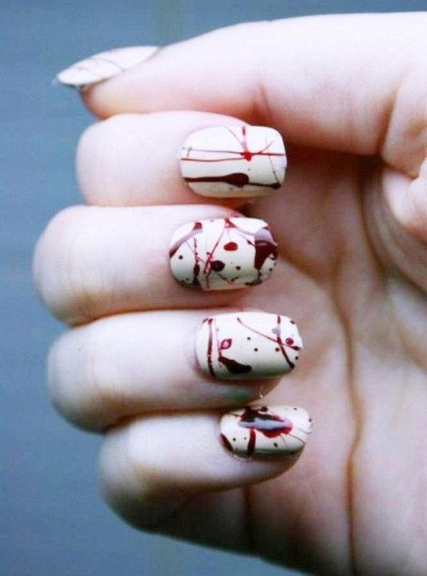 29 chilling blood splatter nail design - 30 Cool Halloween Nail Art Ideas