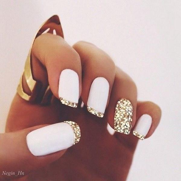 White Matte Polish Gold Glitter French Tips Nail Design