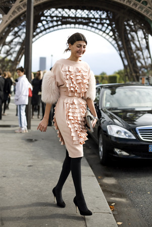 Gorgous! Black heels and opaque tights are her signature!