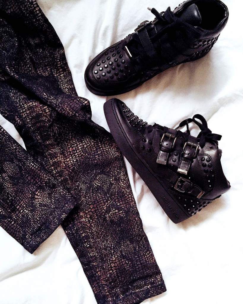 Snakeskin print jeans and pink knot suede plimsolls