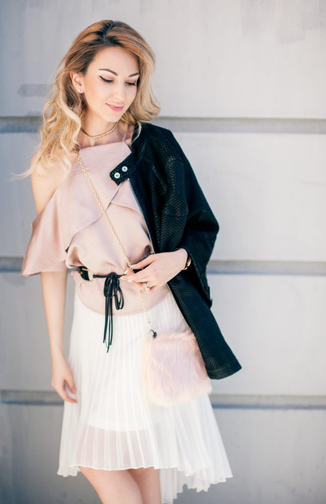 Blush off shoulder pink satin top white pleated high low skirt black leather jacket and pink satin booties