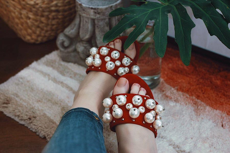 Red suede pearl embellished shoes